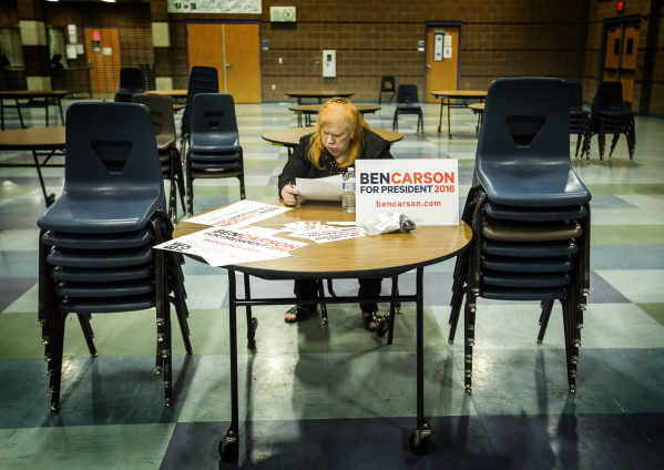 Marilee Maduro, a supporter for Republican presidential candidate Ben Carson, proof reads her speech during the GOP caucus at Canyon Springs High School, 350 E. Alexander Road, in North Las Vegas  ...