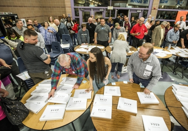 Volunteers search precinct sign in files during the Republican caucus at Canyon Springs High School, 350 E. Alexander Road, in North Las Vegas on Tuesday, Feb.23, 2016. Jeff Scheid/Las Vegas Revie ...