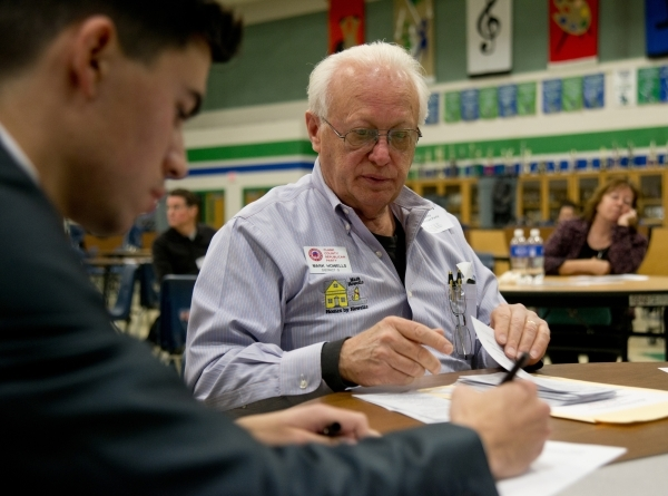 Mark Howells, right, reads ballots aloud as Angelo Gomez counts them during the Nevada Republican presidential caucus at Green Valley High School in Henderson on Tuesday, Feb. 23. 2016. Daniel Cla ...