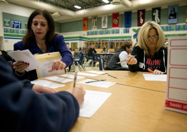 Joseph Nero checks in inside Green Valley High School for the Nevada Republican presidential caucus in Henderson on Tuesday, Feb. 23. 2016. Daniel Clark/Las Vegas Review-Journal Follow @DanJClarkPhoto