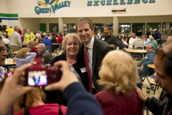 Eric Trump, the son of GOP presidential candidate Donald Trump, takes a photo with Barbara Ryan inside Green Valley High School during the Nevada Republican presidential caucus in Henderson on Tue ...