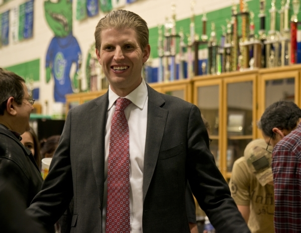 Eric Trump, the son of GOP presidential candidate Donald Trump, speaks with supporters inside Green Valley High School during the Nevada Republican presidential caucus in Henderson on Tuesday, Feb ...