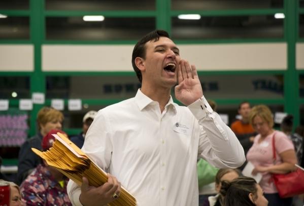 Nevada Assemblyman Stephen Silberkraus, R-Henderson, yells instructions during the Nevada Republican presidential caucus at Green Valley High School in Henderson on Tuesday, Feb. 23. 2016. Daniel  ...