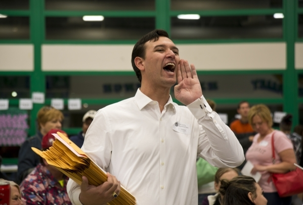 Nevada Assemblyman Stephen Silberkraus, R-Henderson, yells instructions during the Nevada Republican presidential caucus at Green Valley High School in Henderson on Tuesday, Feb. 23. 2016. Daniel  ...