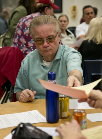 Bill Williams turns in paperwork to become a delegate inside Green Valley High School during the Nevada Republican presidential caucus in Henderson on Tuesday, Feb. 23. 2016. Daniel Clark/Las Vega ...