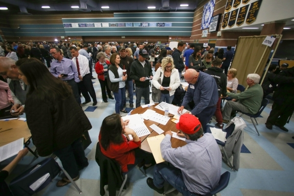 Caucus goers register with their precincts in the cafeteria of Centennial High School during the 2016 Republican caucus in Las Vegas on Tuesday, Feb. 23, 2016. Brett Le Blanc/Las Vegas Review-Jour ...