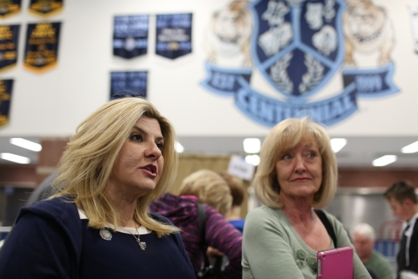 Assemblywoman Michele Fiore, R-Las Vegas, speaks with a reporter while waiting in line to cast her vote during the 2016 Republican caucus at Centennial High School in Las Vegas on Tuesday, Feb. 23 ...