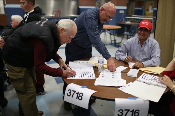 A caucus goer registers to vote in his precinct during the 2016 Republican caucus at Centennial High School in Las Vegas on Tuesday, Feb. 23, 2016. Brett Le Blanc/Las Vegas Review-Journal Follow @ ...