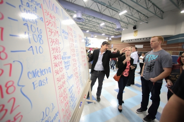 Volunteer Dan Robson, center, helps caucus goers find their way around during the 2016 Republican caucus at Centennial High School in Las Vegas on Tuesday, Feb. 23, 2016. Brett Le Blanc/Las Vegas  ...