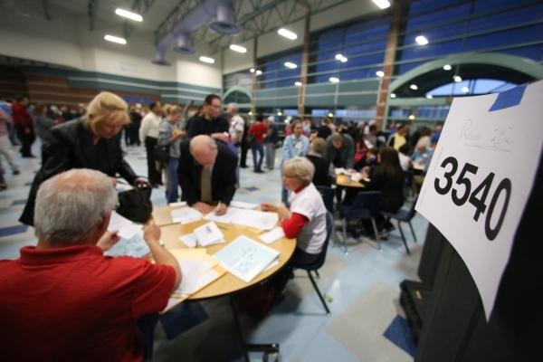 Volunteers register caucus voters in precinct 3540 during the 2016 Republican caucus at Centennial High School in Las Vegas on Tuesday, Feb. 23, 2016. Brett Le Blanc/Las Vegas Review-Journal Follo ...