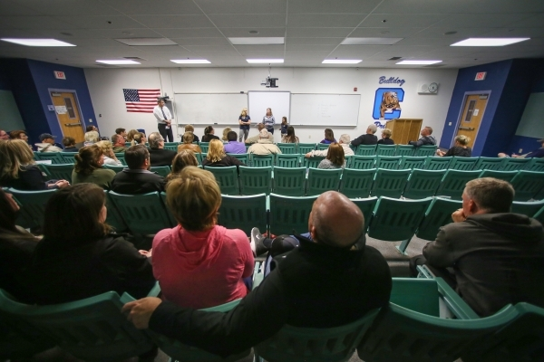 Caucus goers listen as two women make their case for presidential candidate Ted Cruz during the 2016 Republican caucus at Centennial High School in Las Vegas on Tuesday, Feb. 23, 2016. Brett Le Bl ...