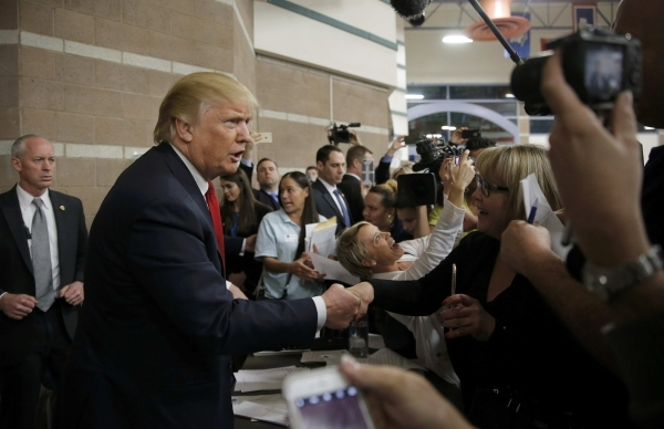 Republican U.S. presidential candidate Donald Trump greets caucus goers as he visits a Nevada Republican caucus site at Palo Verde High School in Las Vegas, Nevada February 23, 2016.    REUTERS/Ji ...