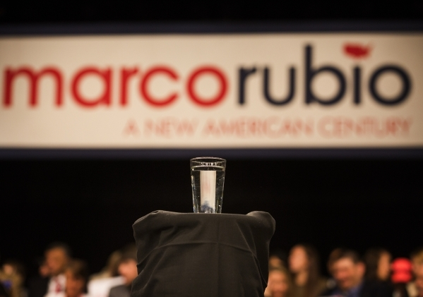 A glass of water is seen on the stage during a rally for Republican presidential candidate Sen. Marco Rubio shakes during a rally at the Silverton Casino, 3333 Blue Diamond Road on Tuesday, Feb.23 ...