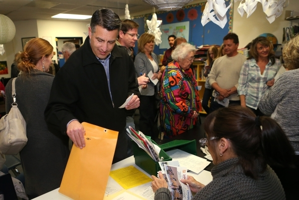 Gov. Brian Sandoval cast the first ballot of his precinct at the Republican caucus at Caughlin Ranch Elementary School in Reno, Nev. on Tuesday, Feb. 23, 2016. Sandoval voted for Rubio but said it ...