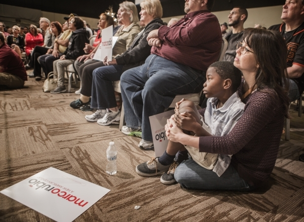Jamie, who declined to give her last name and her son name, 8, watches while Republican presidential candidate Sen. Marco Rubio speaks during a rally at the Silverton Casino, 3333 Blue Diamond Roa ...