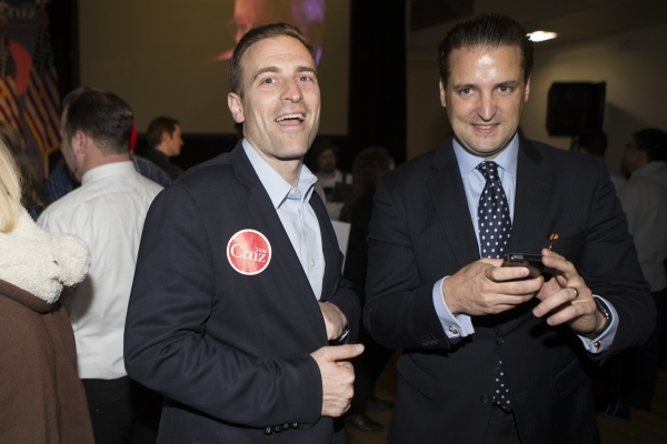 Nevada Attorney General Adam Laxalt, left, speaks with people during a Ted Cruz Republican caucus watch party at Bill and Lillie Heinrich YMCA on Tuesday, Feb. 23, 2016, in Las Vegas. Erik Verduzc ...