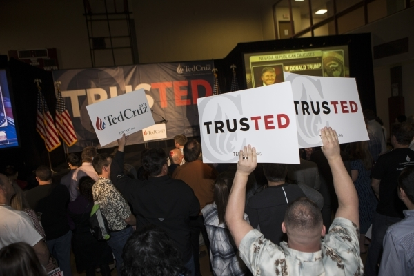 Supporters react to results showing Donald Trump winning the Nevada caucus during a Ted Cruz Republican caucus watch party at Bill and Lillie Heinrich YMCA on Tuesday, Feb. 23, 2016, in Las Vegas. ...