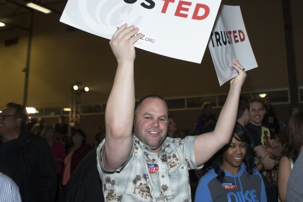 Jason Yoder holds up a sign during a Ted Cruz Republican caucus watch party at Bill and Lillie Heinrich YMCA on Tuesday, Feb. 23, 2016, in Las Vegas. Erik Verduzco/Las Vegas Review-Journal Follow  ...