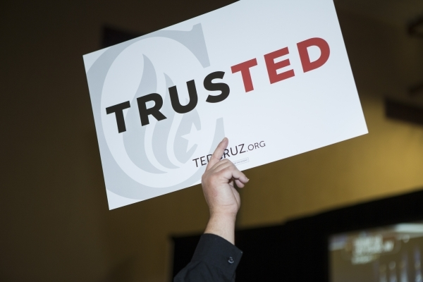 Jamie Ostransder holds up a sign during a Ted Cruz Republican caucus watch party at Bill and Lillie Heinrich YMCA on Tuesday, Feb. 23, 2016, in Las Vegas. Erik Verduzco/Las Vegas Review-Journal Fo ...