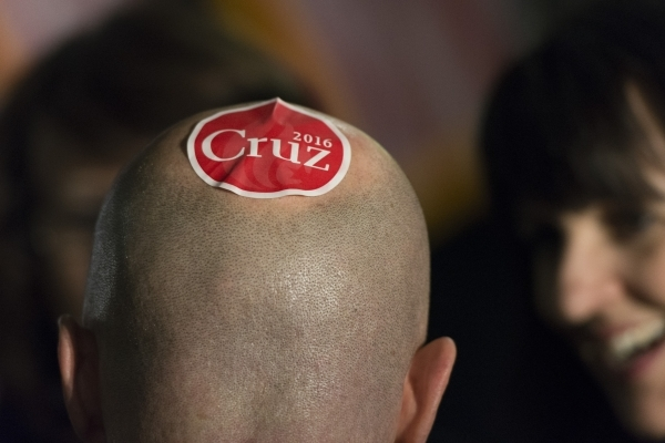 Karl Ennenga wears a sticker on his head in support of Ted Cruz at the GOP caucus watch party for presidential candidate Ted Cruz at the Bill & Lillie Heinrich YMCA at 4141 Meadows Lane in Las ...