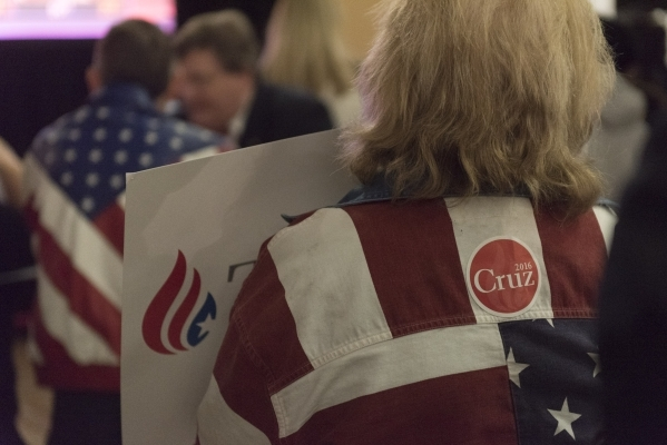 Ted Cruz supporters watch the results at the GOP caucus watch party for presidential candidate Ted Cruz at the Bill & Lillie Heinrich YMCA at 4141 Meadows Lane in Las Vegas Tuesday, Feb. 23, 2 ...