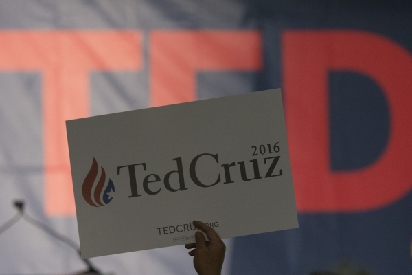 A sign is raised above the crowd at the GOP caucus watch party for presidential candidate Ted Cruz at the Bill & Lillie Heinrich YMCA at 4141 Meadows Lane in Las Vegas Tuesday, Feb. 23, 2016.  ...