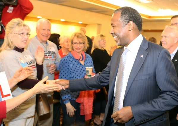 Republican presidential candidate Dr. Ben Carson shakes hands with supporters during the watch party at Embassy Suites Convention Center on Tuesday, Feb. 23, 2016, in Las Vegas. Bizuayehu Tesfaye/ ...