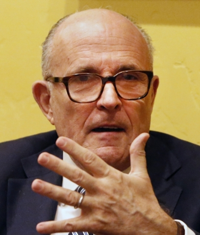 Former New York Mayor Rudolph Giuliani speaks to a reporter prior to being introduced by Greenberg Traurig to Las Vegas clients as the firm's global chair of cybersecurity and crisis managem ...