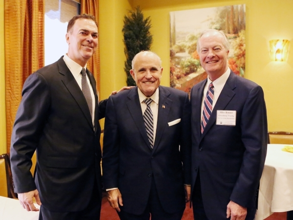 Former New York Mayor Rudolph Giuliani, center, Jim Mace, left, and Mike Bonner, both of Greenberg Traurig Co-Managing shareholder, pose for a photo prior to Guiliani being introduced to Las Vegas ...