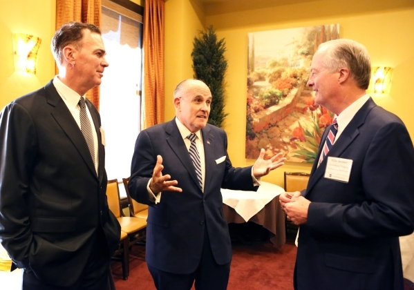Former New York Mayor Rudolph Giuliani, center, talks to Jim Mace, left, and Mike Bonner, both of Greenberg Traurig Co-Managing shareholder, prior to Guiliani being introduced to Las Vegas clients ...