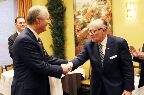 Mike Bonner, Greenberg Traurig Co-Managing shareholder, left, introduces former New York Mayor Rudolph Giuliani, right, to Las Vegas clients as the firm's global chair of cybersecurity and c ...