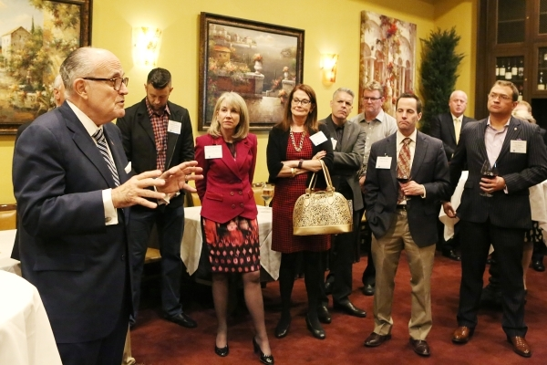 Former New York Mayor Rudolph Giuliani speaks after being introduced by Greenberg Traurig to Las Vegas clients as the firm's global chair of cybersecurity and crisis management Thursday, Feb ...