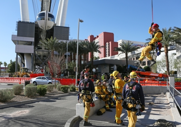 Henderson Fire Department Capt. Jimmy Petrolia, right, finishes rappeling from a pod on the High Roller at the Linq hotel-casino Wednesday, Feb. 24, 2016, in Las Vegas. Las Vegas Fire & Rescue ...