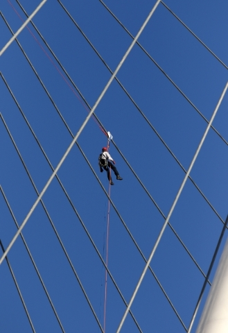 A firefighter trains on the High Roller at the Linq hotel-casino Wednesday, Feb. 24, 2016, in Las Vegas. Las Vegas Fire & Rescue and the Henderson Fire Department hosted a rescue training sess ...