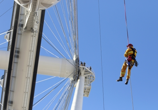 Henderson Fire Department Capt. Jimmy Petrolia rappels from a pod on the High Roller at the Linq hotel-casino Wednesday, Feb. 24, 2016, in Las Vegas. Las Vegas Fire & Rescue and the Henderson  ...