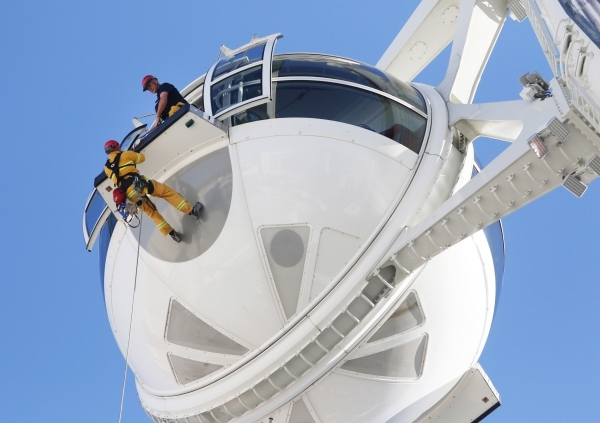 Henderson Fire Department Capt. Jimmy Petrolia, left, rappels from a pod on the High Roller at the Linq hotel-casino Wednesday, Feb. 24, 2016, in Las Vegas. Las Vegas Fire & Rescue and the Hen ...
