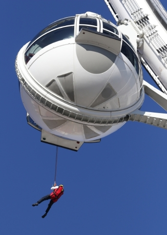 Orange County Fire Rescue Battalion Chief Dave Hollenbach rappels from a pod on the High Roller at the Linq hotel-casino Wednesday, Feb. 24, 2016, in Las Vegas. Las Vegas Fire & Rescue and the ...