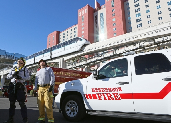 Las Vegas Fire & Rescue firefighters Arnold Aoshima, left, and Jeff Wilde watch fellow firefighters train on the High Roller at the Linq hotel-casino Wednesday, Feb. 24, 2016, in Las Vegas. LV ...
