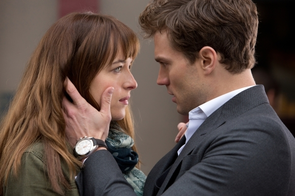 "In this image released by Universal Pictures and Focus Features, Dakota Johnson, left, and Jamie Dornan appear in a scene from ""Fifty Shades of Grey."" (Universal Pictures and Focus Features)"