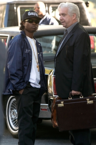 "Eazy-E (Jason Mitchell), left, speaks with N.W.A manager Jerry Heller (Paul Giamattie) in a scene from ""Straight Outta Compton."" ( Jaimie Trueblood/Universal Studios)"