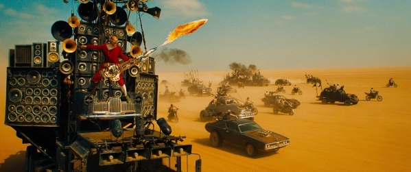 "Coma, The Doof Warrior, is shown in a scene from ""Mad Max: Fury Road."" (Courtesy of Warner Bros. Pictures)"