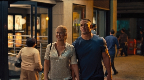"Amy Schumer and John Cena appear in a scene from ""Trainwreck."" (Courtesy Universal Pictures)"