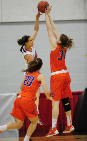 UNLV guard Brooke Johnson (2) passes in front of Boise State guard Marijke Vanderschaaf (31) in the second quarter of their basketball game at the Cox Pavilion in Las Vegas Wednesday, Feb. 24, 201 ...
