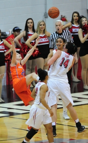 Boise State guard Marta Hermida (20) falls backwards while trying to pass in front of UNLV center Aley Rohde (14) and guard Dylan Gonzalez in the fourth quarter of their basketball game at the Cox ...