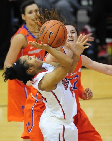 Boise State guard Marta Hermida, right, fouls UNLV Rebels guard Nikki Wheatley (10) in the fourth quarter of their basketball game at the Cox Pavilion in Las Vegas Wednesday, Feb. 24, 2016. UNLV d ...