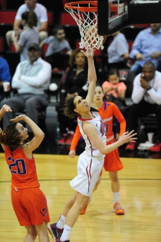 UNLV Rebels guard Brooke Johnson (2) is fouled while going up for a shot against Boise State in the fourth quarter of their basketball game at the Cox Pavilion in Las Vegas Wednesday, Feb. 24, 201 ...