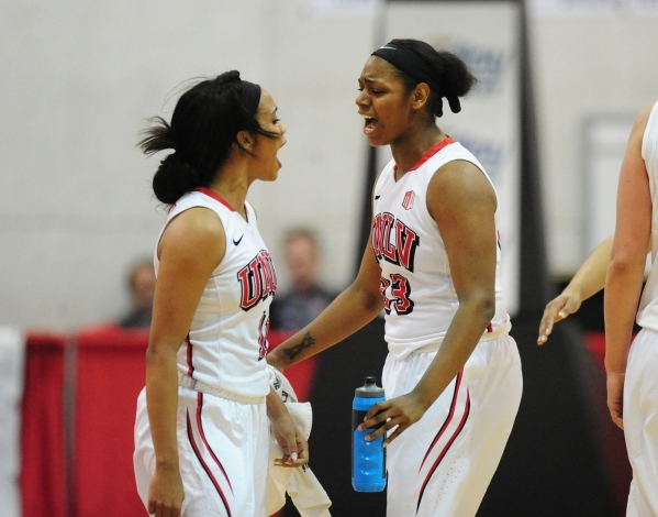 UNLV Rebels forward Jordyn Bell, right, and UNLV Rebels guard Dylan Gonzalez react after Gonzalez made a three-point basket as time expired in the third quarter of their basketball game at the Cox ...