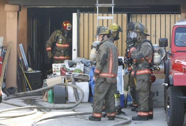 Clark County firefighters are seen after battling a house fire at 4943 Lana Drive on Wednesday, Feb. 24, 2016. One person died in the fire. Bizuayehu Tesfaye/Las Vegas Review-Journal Follow @bizut ...