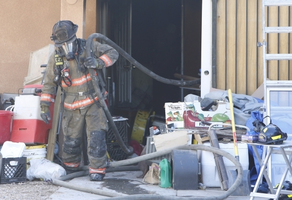 A Clark County firefighter pulls out a water hose after battling a house fire at 4943 Lana Drive on Wednesday, Feb. 24, 2016. One person died in the fire. Bizuayehu Tesfaye/Las Vegas Review-Journa ...
