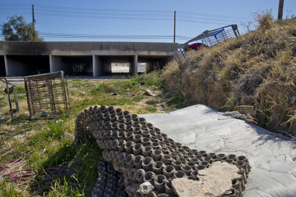 A discarded mattress lies in a drainage ditch near a number of homeless camps in a neighborhood that has seen a dramatic rise in poverty near Nellis and Las Vegas boulevards on Thursday, Feb. 25,  ...